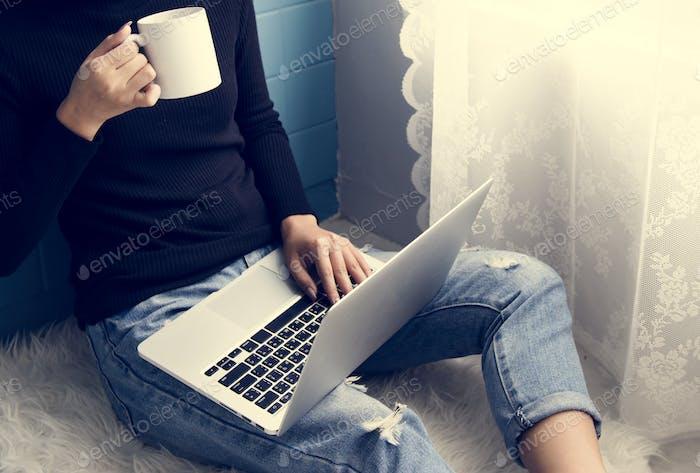 Clsoeup of woman using computer laptop