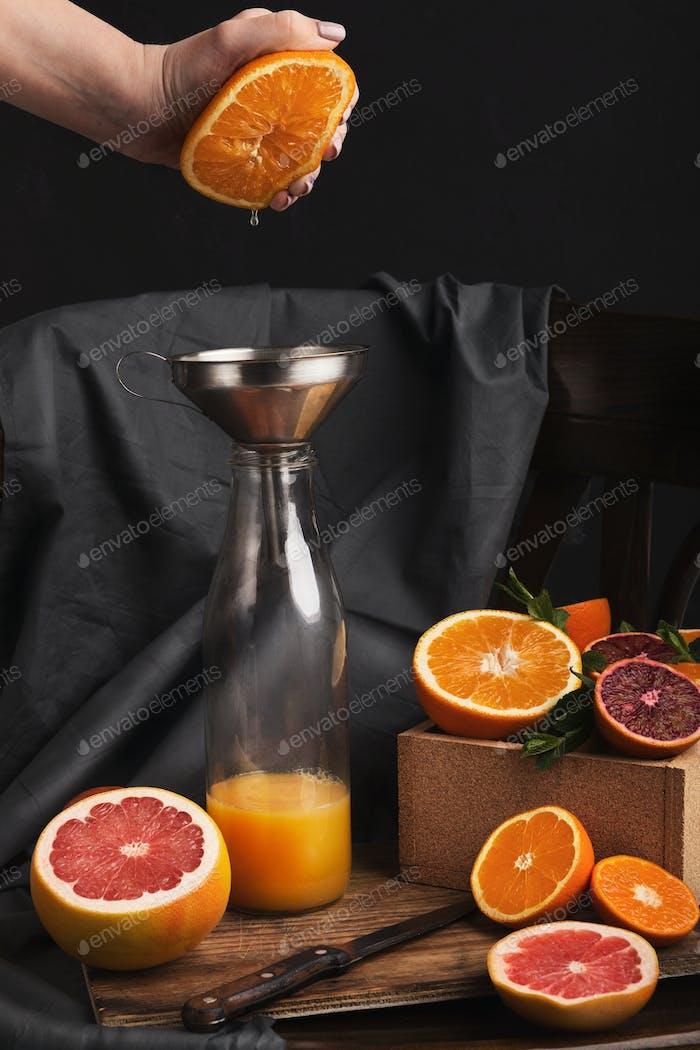 Preparing citrus fresh on black old chair