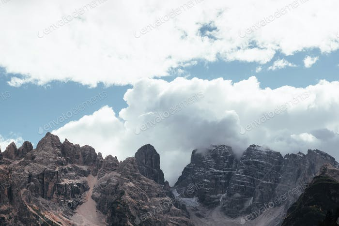 Awesome scenic highlands that touching the clouds. Landscape of high mountains