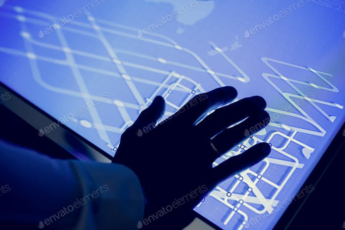 Hand on a cyber space table