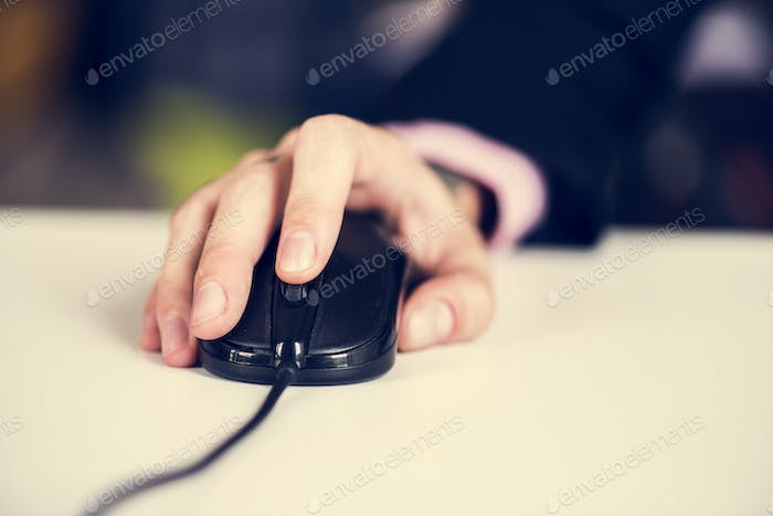 Businesswoman using mouse
