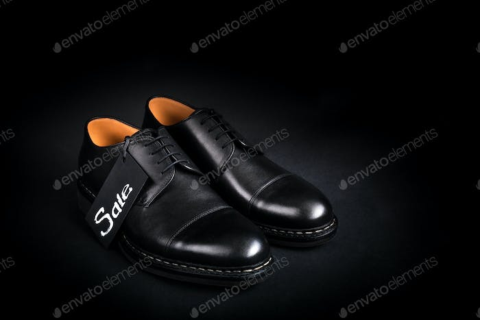Black oxford shoes on  background. Back view. Copy space.