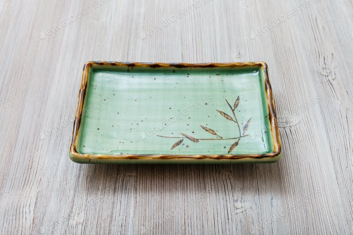 green square plate on gray brown table