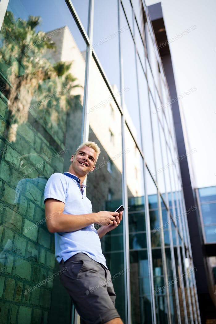 Portrait of a handsome man in urban background