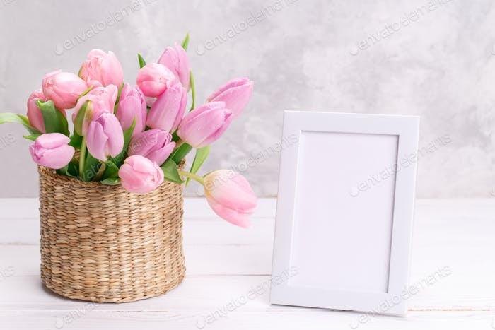 Pink tulips and picture frame