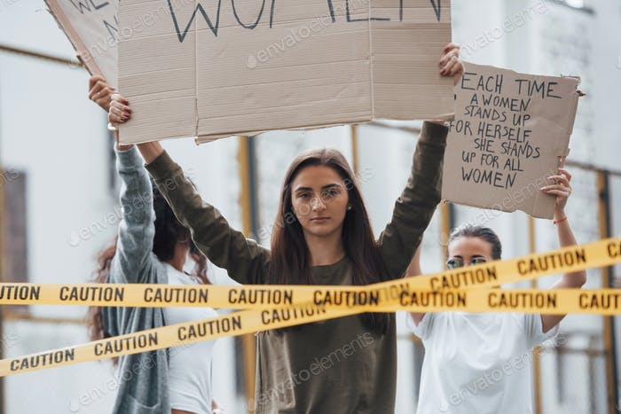 Hear us. Group of feminist women have protest for their rights outdoors