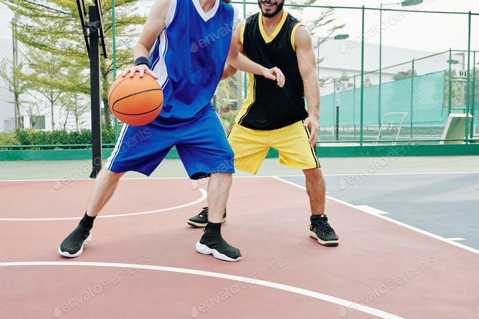 Basketball players training outdoor