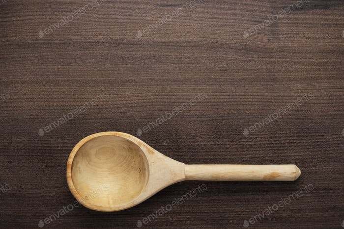 Wooden Spoon On The Blue Table
