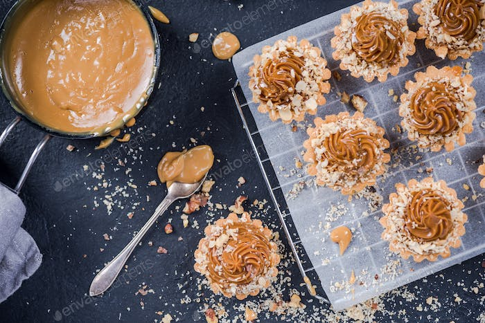 Homemade satled caramel or toffee cupcakes with swirl