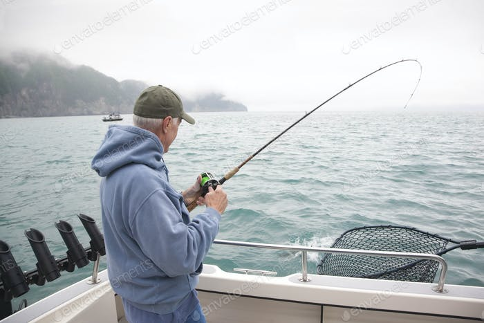 Senior Fisherman in Alaska Catches Silver Salmon