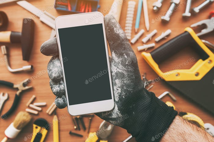 Smart phone app for handyman, repairman holding mobile phone