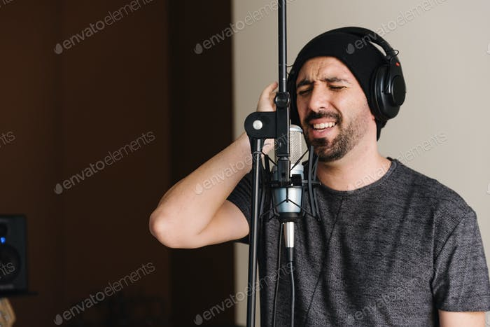 Young man singing with mic.