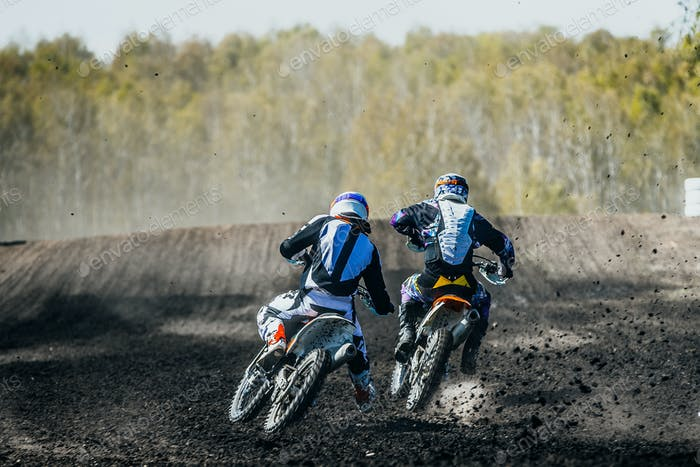 Two racer on motorcycles
