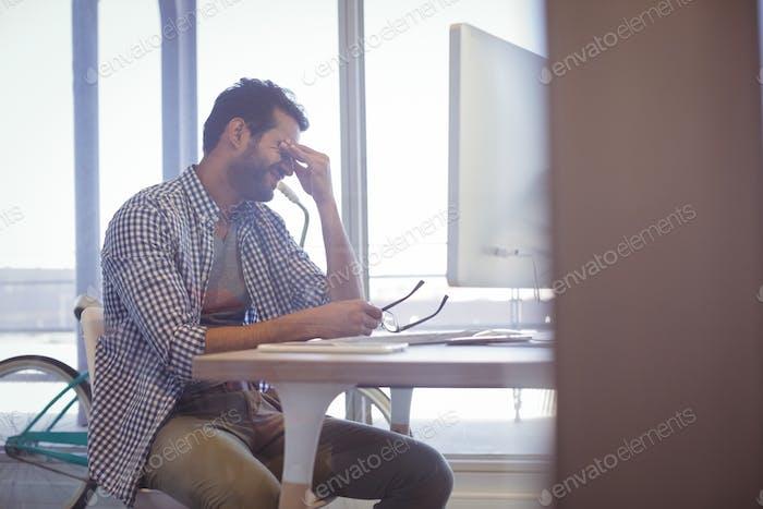 Depressed businessman sitting at desk