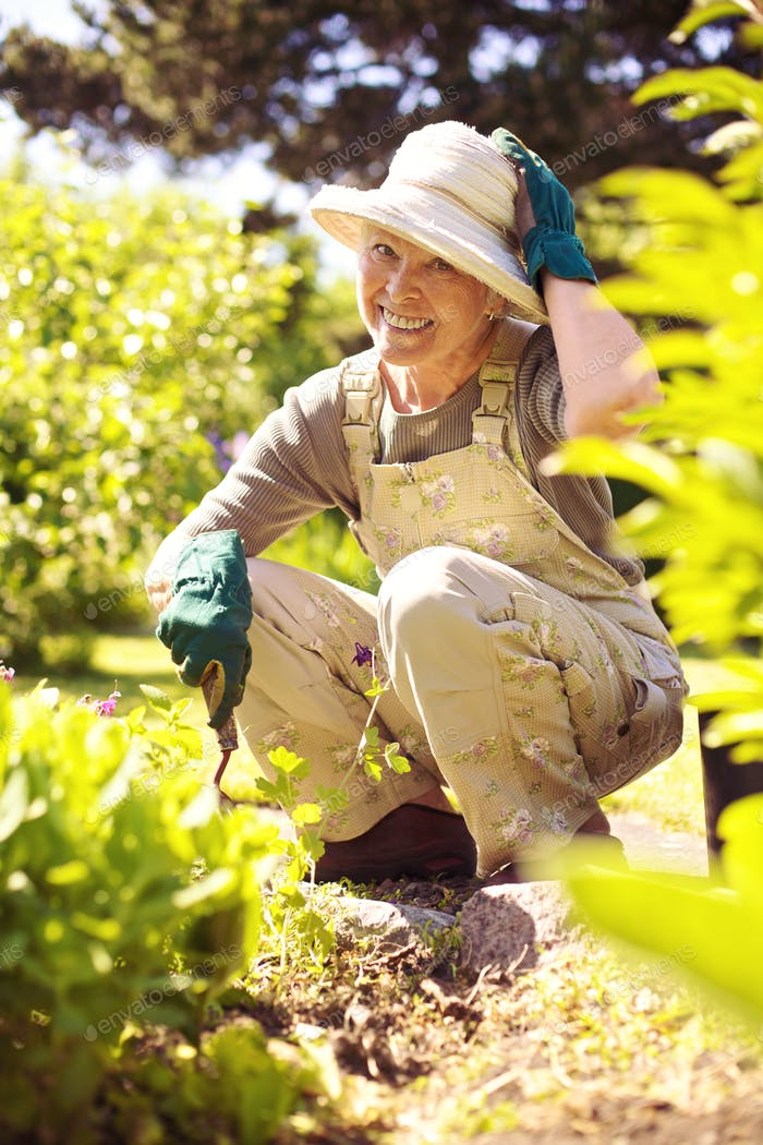 Happy older woman gardening