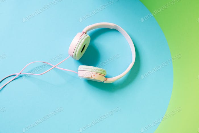 Overhead view of a big wired headphones lying in the studio