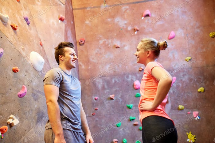 Thumbnail for man and woman talking at indoor climbing gym wall