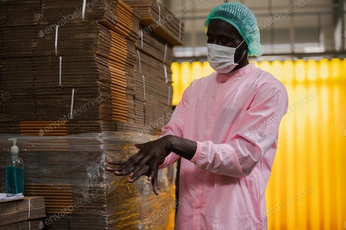 African American worker man working in industrial factory, occupation engineer manufacturing job