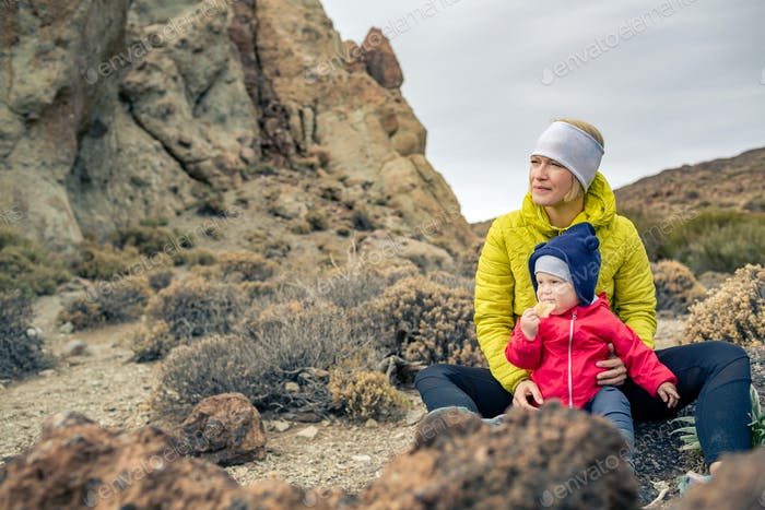 Happy mother with little boy travelling in mountains