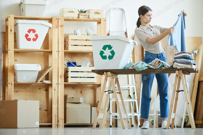 Woman sorting wardrobe in containers