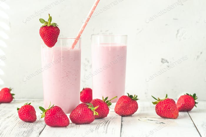 Two glasses of strawberry shake