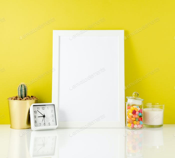 Blank white frame, clock, succulent, candy