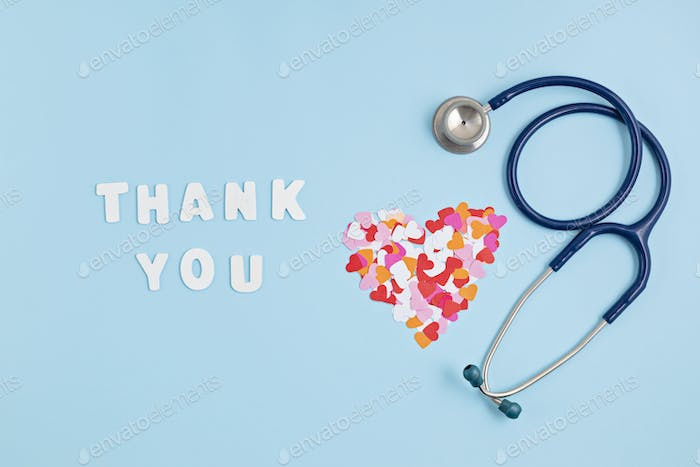 Hearts confetti and text thank you. Expressing gratitude to doctors and nurses