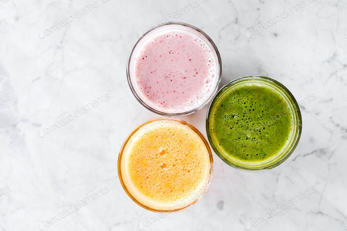 Glasses with colorful vegetable abd fruits smoothie. Top view, copy soace. Summer Healthy Drink