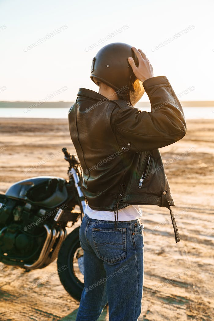 Back view of a young man wearing leather jacket