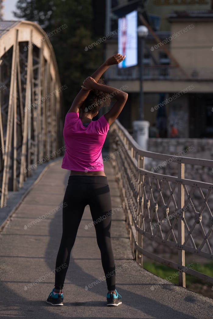 Black woman doing warming up and stretching