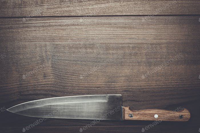 kitchen knife on brown wooden table