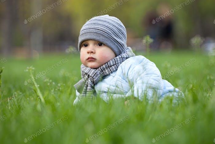 Portrait of cute little boy in park in spring