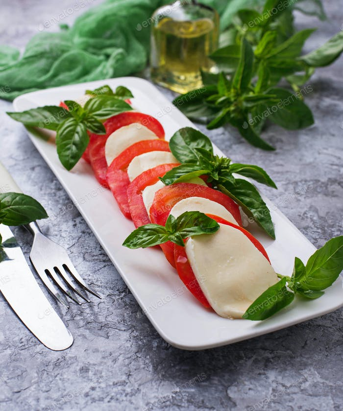 Italian caprese salad with mozzarella, tomatoes and basil