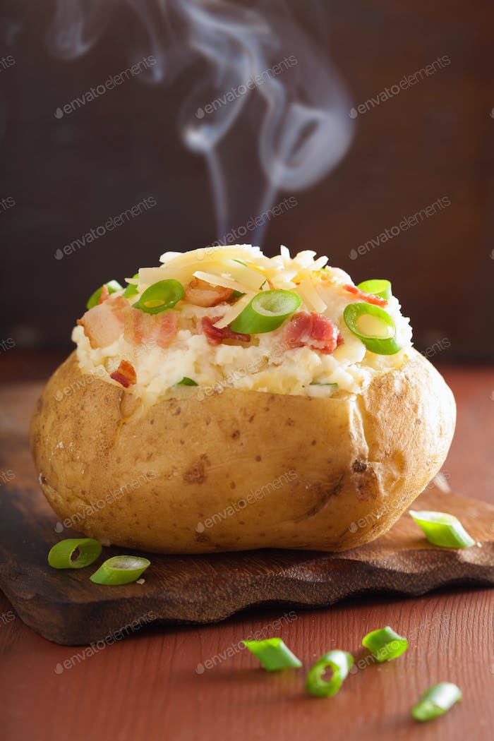 baked stuffed potato in jacket with bacon and cheese