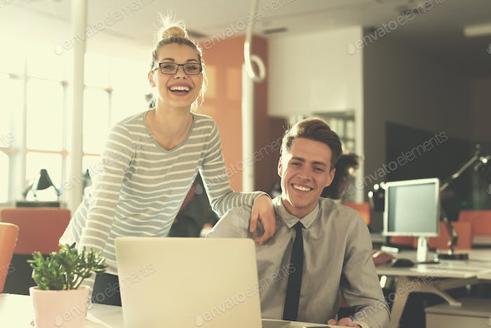 Two Business People Working With laptop in office