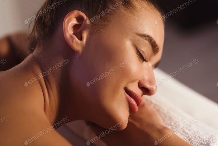 Spa Treatments. Woman Relaxing At Beauty Salon