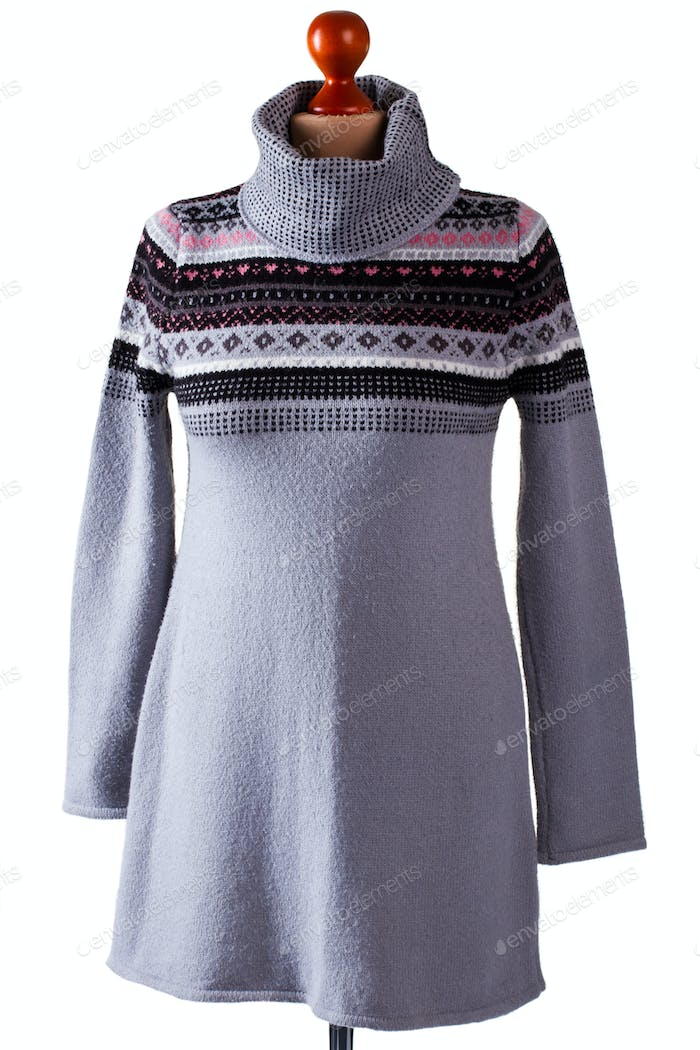 Gray sweater with high collar.