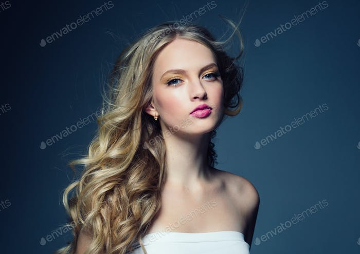 Blonde curly hair woman young female model with pink lips and beautiful beauty hairstyle