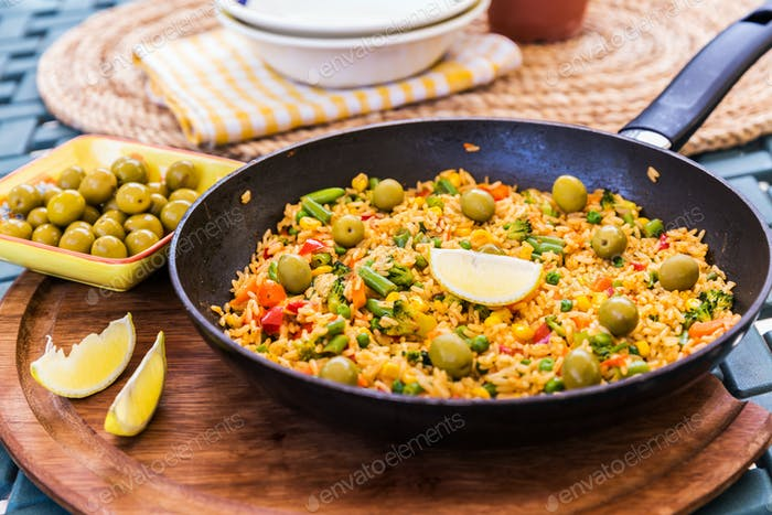 Vegetarian paella with olives