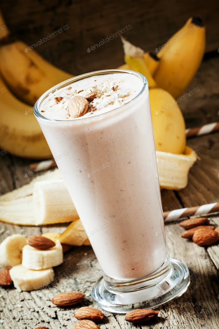 Dairy smoothies with ground almonds and banana, healthy eating, selective focus
