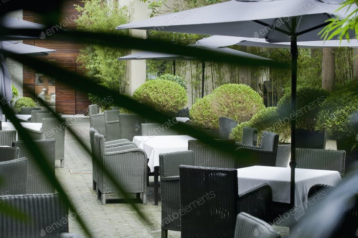 Seating on a paved patio with sun umbrellas