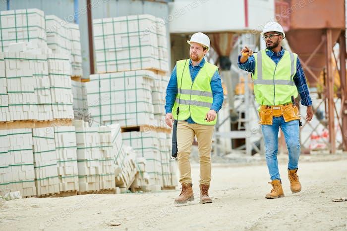 Building inspectors walking on construction site