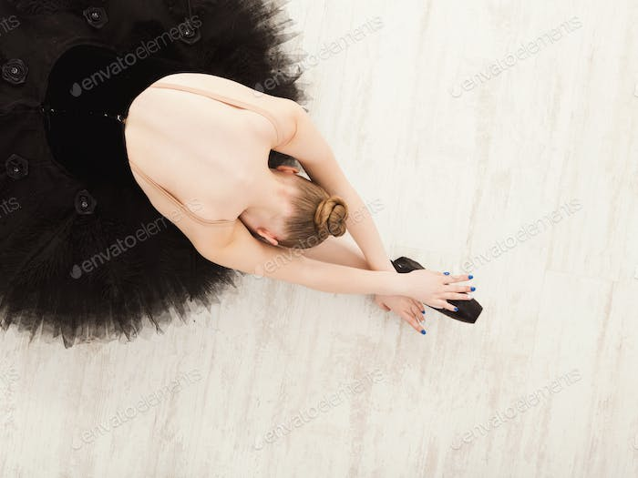 Graceful Ballerina stretching, ballet background, top view