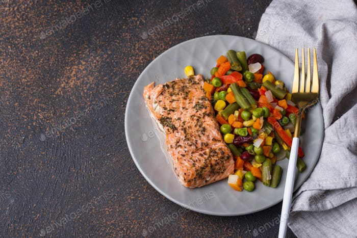 Baked salmon with boiled vegetable