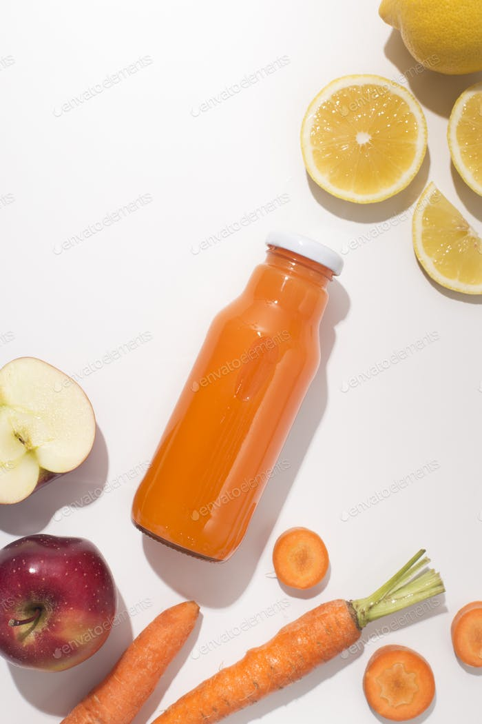 Natural organic and healthy juice in glass bottle with ingredients