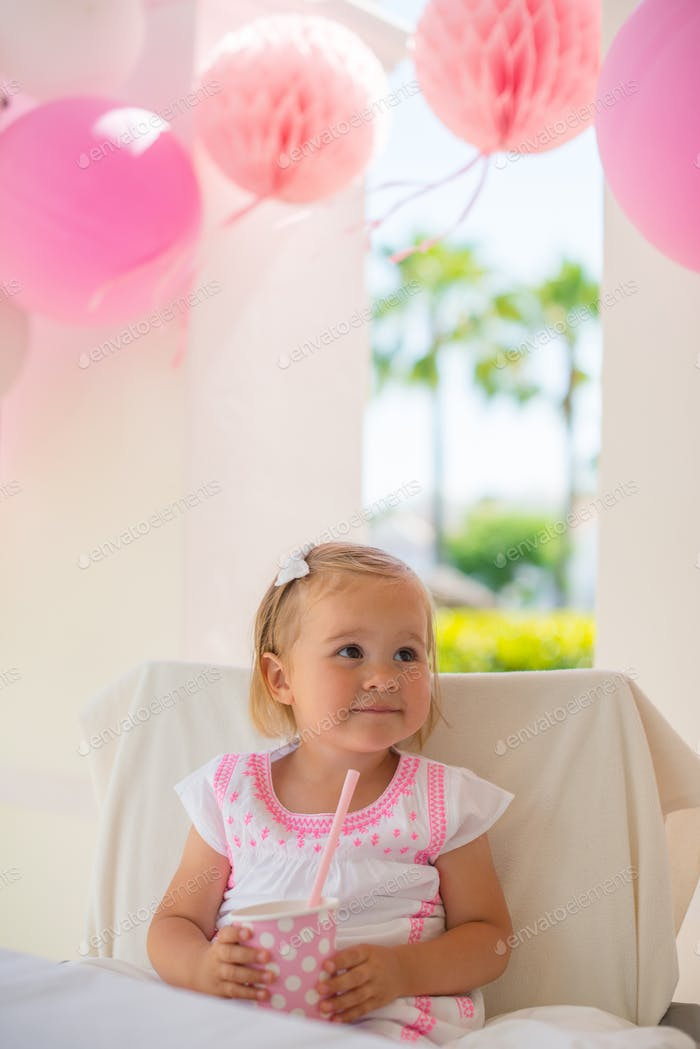 Smiling Little Girl Holding Paper Pink Cup