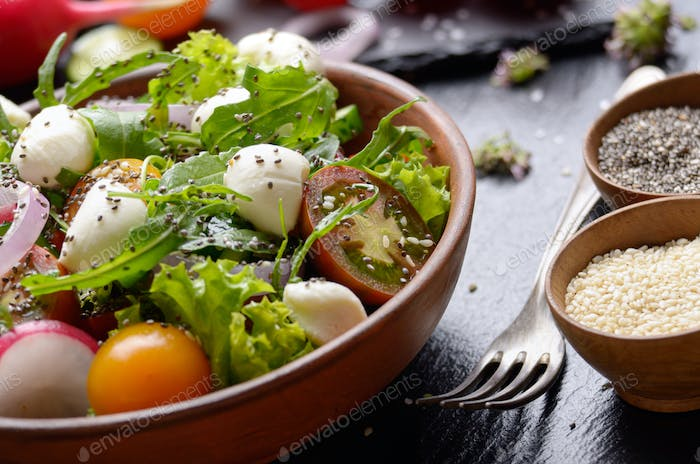 Vegetable salad with mozzarella cheese, lettuce, cherry tomatoes