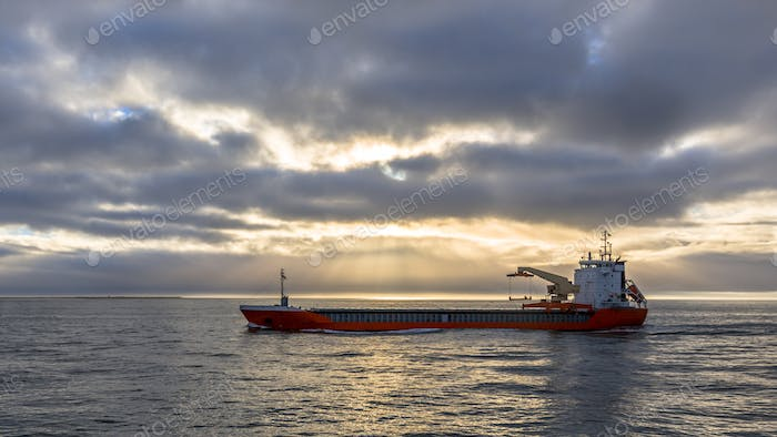 Freight ship on North Sea under dramatic sky