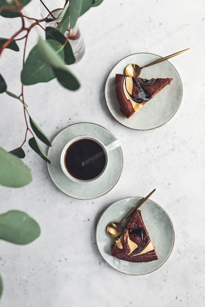 Cup of black coffee with chocolate cakes