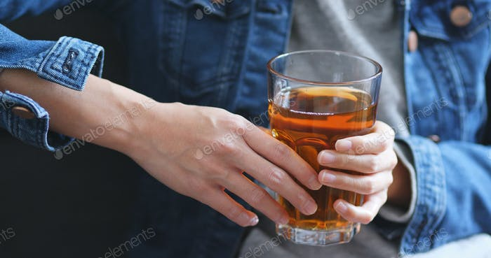 Woman holding hot tea